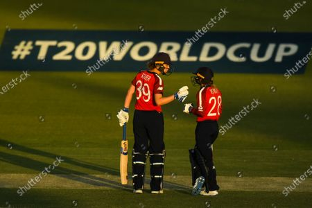 Stock Picture of Natalie Sciver (L) and Danielle Wyatt (R) of England react during the Women's T20 World Cup cricket match between England and Pakistan at Manuka Oval in Canberra, Australia, 28 February 2020.