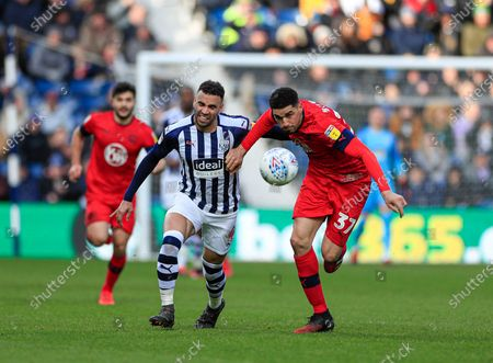 29th February 2020, The Hawthorns, West Bromwich, England; Sky Bet Championship, West Bromwich Albion v Wigan Athletic : Leon Balogun (37) of Wigan Athletic and Hal Robson-Kanu (4) of West Bromwich Albion challenge for the ball