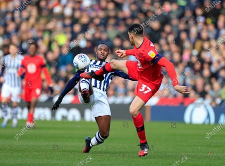 29th February 2020, The Hawthorns, West Bromwich, England; Sky Bet Championship, West Bromwich Albion v Wigan Athletic : Rekeem Harper (16) of West Bromwich Albion and Leon Balogun (37) of Wigan Athletic challenge for the ball