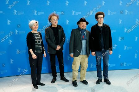 Stock Image of Producer Catherine Dussart, composer Marc Marder, director Rithy Panh, and writer Christophe Bataille attend the 'Irradies' (Irradiated) photocall during the 70th annual Berlin International Film Festival (Berlinale), in Berlin, Germany, 28 February 2020. The movie is presented in the Official Competition at the Berlinale that runs from 20 February to 01 March 2020.
