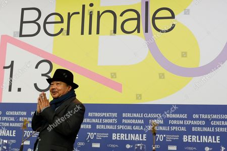 Director Rithy Panh arrives at a news conference for the film 'Irradies', Irradiated, during the 70th International Film Festival Berlin, Berlinale in Berlin, Germany