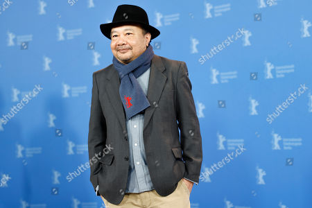 Director Rithy Panh poses during a photo-call for the film 'Irradies', Irradiated, during the 70th International Film Festival Berlin, Berlinale in Berlin, Germany
