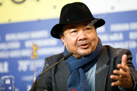 Director Rithy Panh answers questions at a news conference for the film 'Irradies', Irradiated, during the 70th International Film Festival Berlin, Berlinale in Berlin, Germany