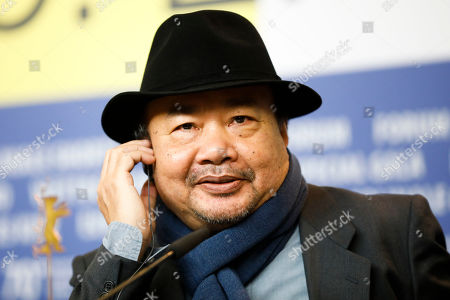 Director Rithy Panh listens to questions at a news conference for the film 'Irradies', Irradiated, during the 70th International Film Festival Berlin, Berlinale in Berlin, Germany