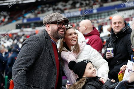 West Ham United versus Southampton; West Ham United fan and Comedian Tom Davis posing with West Ham United fans inside the London Stadium before kick off