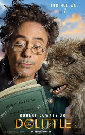 Stock Picture of Dolittle (2020) Poster Art. Robert Downey Jr. as Dr. John Dolittle and Dog Jip (Tom Holland)