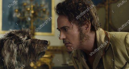 Dog Jip (Tom Holland) and Robert Downey Jr. as Dr. John Dolittle