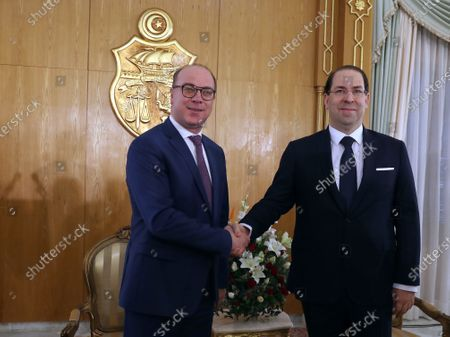 Outgoing Tunisian Prime Minister Youssef Chahed (R) shakes hands with new Prime Minister Elyes Fakhfakh (L) during a ceremony on the occasion of assuming office for the new government, Tunis, Tunisia, 28 February 2020. The government of Elyes Fakhfakh won a parliament confidence vote by 129 to 77 against.