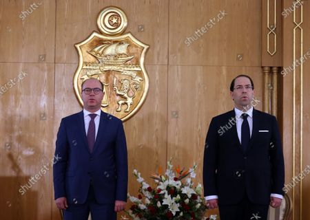 Outgoing Tunisian Prime Minister Youssef Chahed (R) and new Prime Minister Elyes Fakhfakh (L) attend a ceremony on the occasion of assuming office for the new government, Tunis, Tunisia, 28 February 2020. The government of Elyes Fakhfakh won a parliament confidence vote by 129 to 77 against.