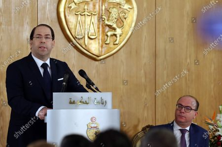Outgoing Tunisian Prime Minister Youssef Chahed (L) speaks as new Prime Minister Elyes Fakhfakh (R) looks on during a ceremony on the occasion of assuming office for the new government, Tunis, Tunisia, 28 February 2020. The government of Elyes Fakhfakh won a parliament confidence vote by 129 to 77 against.