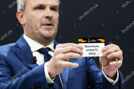 German former soccer player Dietmar Hamann shows a ticket of Manchester United during the UEFA Europa League 2019/20 Round of 16 draw, at the UEFA Headquarters in Nyon, Switzerland, 28 February 2020.