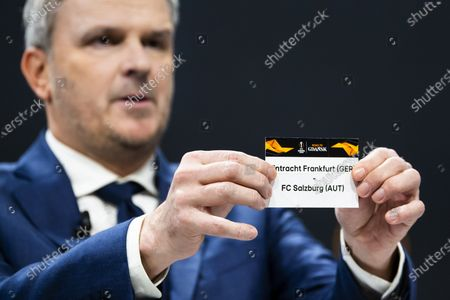 German former soccer player Dietmar Hamann shows a ticket of FC Salzburg and Eintracht Frankfurt during the UEFA Europa League 2019/20 Round of 16 draw, at the UEFA Headquarters in Nyon, Switzerland, 28 February 2020.