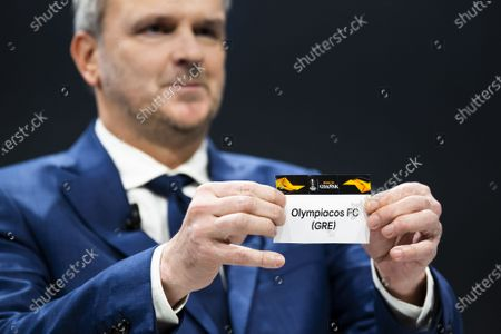 German former soccer player Dietmar Hamann shows a ticket of Olympiacos FC during the UEFA Europa League 2019/20 Round of 16 draw, at the UEFA Headquarters in Nyon, Switzerland, 28 February 2020.