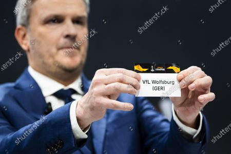 Stock Image of German former soccer player Dietmar Hamann shows a ticket of VfL Wolfsburg during the UEFA Europa League 2019/20 Round of 16 draw, at the UEFA Headquarters in Nyon, Switzerland, 28 February 2020.