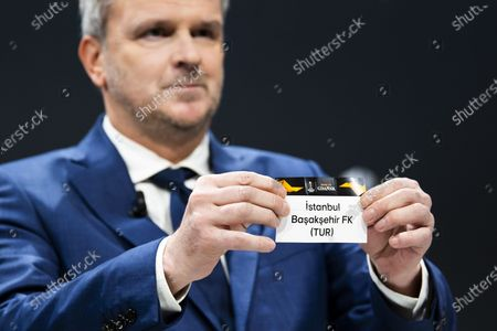 German former soccer player Dietmar Hamann shows a ticket of Istanbul Basaksehir FK during the UEFA Europa League 2019/20 Round of 16 draw, at the UEFA Headquarters in Nyon, Switzerland, 28 February 2020.