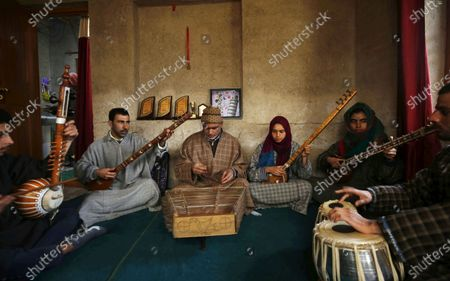 Teacher Mohammad Yousuf (C) teaches Kashmiri Muslim girls and boys to play instruments and sing Sufi music in Shilwat village, Bandipora district, Kashmir, India, 28 February 2020. Introduced in Kashmir in 15th century from Iran, Sufiana music, played with mystic poetry and Santoor, Rabab, Tabla and other musical instruments, is struggling for its survival in Kashmir.