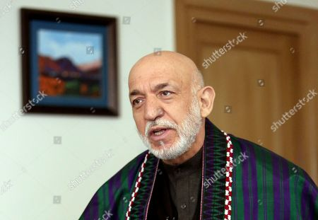 Stock Image of Former Afghan President Hamid Karzai speaks during an interview with The Associated Press in Kabul, Afghanistan, . On the eve of a potentially historic deal with the U.S. and the Taliban to end 18 years of war in Afghanistan, former Karzai welcomed the signing of the agreement, thanked Americans for their generosity, but had harsh words for the U.S. government and military