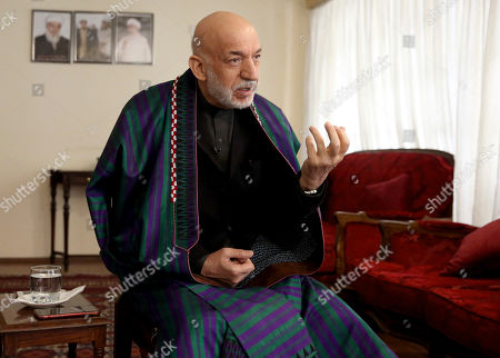 Stock Picture of Former Afghan President Hamid Karzai speaks during an interview with The Associated Press in Kabul, Afghanistan, . On the eve of a potentially historic deal with the U.S. and the Taliban to end 18 years of war in Afghanistan, former Karzai welcomed the signing of the agreement, thanked Americans for their generosity, but had harsh words for the U.S. government and military