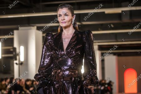 Danish model Helena Christensen presents a creation by French designer Olivier Rousteing for Balmain fashion house during the Paris Fashion Week, in Paris, France, 28 February 2020. The presentation of the Fall-Winter 2020/21 women's collection runs from 24 February to 03 March 2020.
