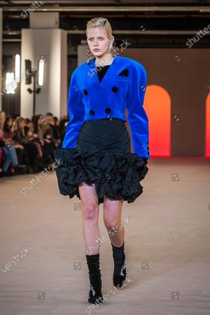 Dutch model Marjan Jonkman presents a creation by French designer Olivier Rousteing for Balmain fashion house during the Paris Fashion Week, in Paris, France, 28 February 2020. The presentation of the Fall-Winter 2020/21 women's collection runs from 24 February to 03 March 2020.