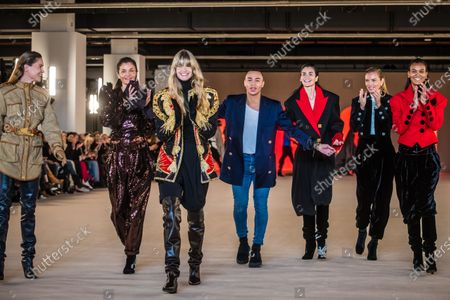 French designer Olivier Rousteing (C) poses with models (L-R) Erin Wasson, Helena Christensen, Julia Stegner, Caroline Ribeiro, Esther Canadas and Liya Kebede after the presentation of his collection for Balmain fashion house during the Paris Fashion Week, in Paris, France, 28 February 2020. The presentation of the Fall-Winter 2020/21 women's collection runs from 24 February to 03 March 2020.