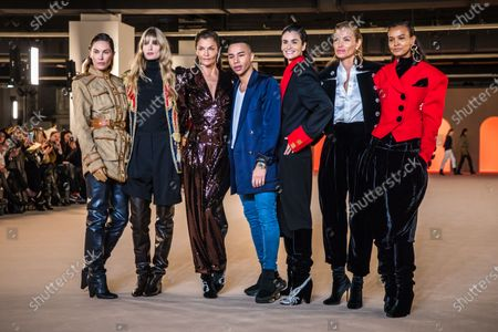 French designer Olivier Rousteing (C) poses with models (L-R) Erin Wasson, Julia Stegner, Helena Christensen, Caroline Ribeiro, Esther Canadas and Liya Kebede after the presentation of his collection for Balmain fashion house during the Paris Fashion Week, in Paris, France, 28 February 2020. The presentation of the Fall-Winter 2020/21 women's collection runs from 24 February to 03 March 2020.
