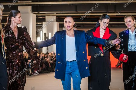 French designer Olivier Rousteing (C) poses with models (L-R) Helena Christensen, Caroline Ribeiro and Esther Canadas  after the presentation of his collection for Balmain fashion house during the Paris Fashion Week, in Paris, France, 28 February 2020. The presentation of the Fall-Winter 2020/21 women's collection runs from 24 February to 03 March 2020.