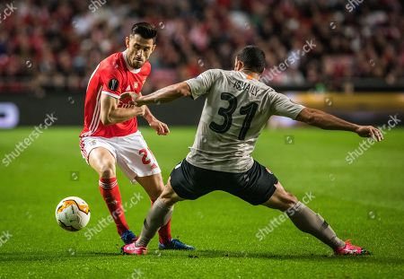 Luis Miguel Afonso 'Pizzi' of SL Benfica and Ismaily Goncalves dos Santos of FC Shakhtar Donetsk are seen in action
