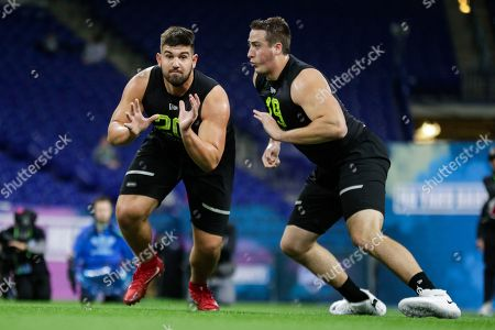 Temple offensive lineman Matt Hennessy (20) and North Carolina offensive lineman Charlie Heck run a drill at the NFL football scouting combine in Indianapolis