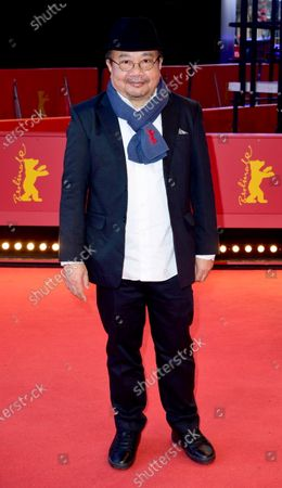 Rithy Panh arrives for the premiere of 'Irradies' (Irradiated) during the 70th annual Berlin International Film Festival (Berlinale), in Berlin, Germany, 28 February 2020. The movie is presented in the Official Competition at the Berlinale that runs from 20 February to 01 March 2020.