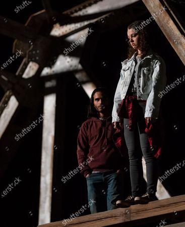 Stock Photo of Mehdi Dehbi as Al-Masih and Stefania LaVie Owen as Rebecca Iguero