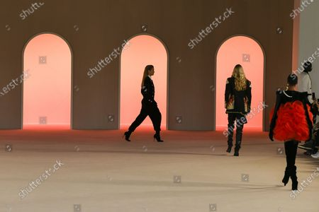 Helena Christensen and models on the catwalk