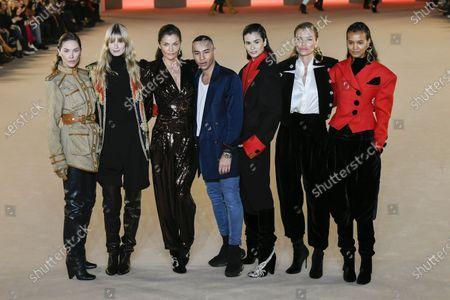 Stock Image of Olivier Rousteing, Erin Wasson, Julia Stegner, Helena Christensen, Caroline Ribeiro, Esther Canadas and Liya Kebede on the catwalk