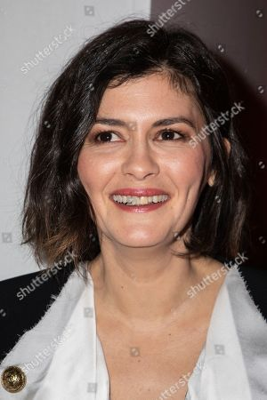 Audrey Tautou poses for photographers prior to the Balmain fashion collection during Women's fashion week Fall/Winter 2020/21 presented in Paris