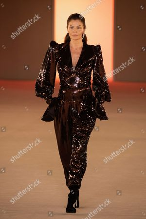 Helena Christensen wears a creation for the Balmain fashion collection during Women's fashion week Fall/Winter 2020/21 presented in Paris