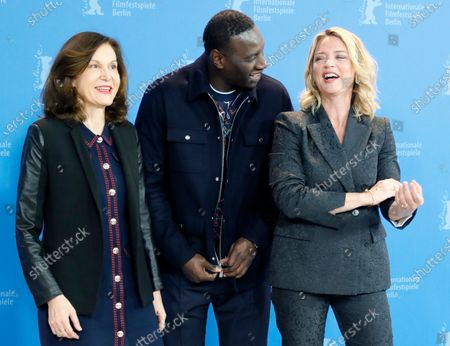 Anne Fontaine,  Omar Sy and Virginie Efira pose during the 'Police' (Night Shift) photocall during the 70th annual Berlin International Film Festival (Berlinale), in Berlin, Germany, 28 February 2020. The movie is presented in the Berlinale Special section at the Berlinale that runs from 20 February to 01 March 2020.