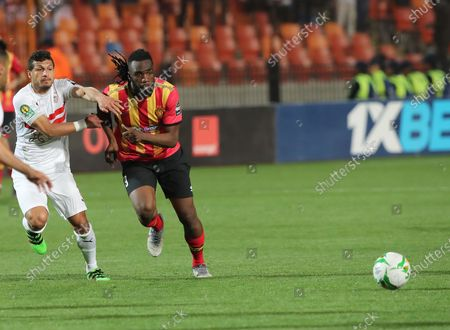 ES Tunis player Ibrahim Ouattara (R) in action against Zamalek player Tarek Hamed (L) during the CAF Champions League quarterfinal, first leg, soccer match between Zamalek and ES Tunis at Cairo Stadium in Cairo, Egypt, 28 February  2020.