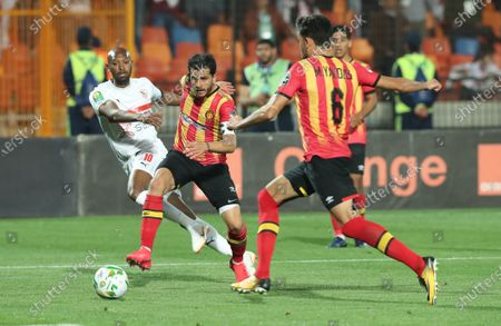 Stock Picture of ES Tunis player Khelil Chammam (C) and Mohamed Ali (R) in action against Zamalek   player Shikabala (L) during the CAF Champions League quarterfinal, first leg, soccer match between Zamalek and ES Tunis at Cairo Stadium in Cairo, Egypt, 28 February  2020.