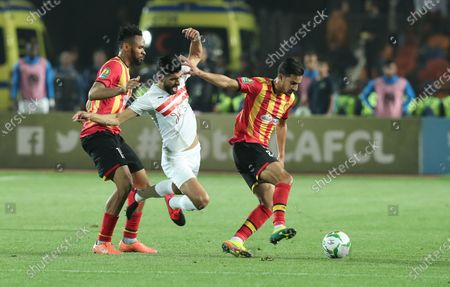 ES Tunis player Foussef Abdelli (L) and Mohamed Amin (R) in action against  Zamalek   player Ferjani Sassi (C) during the CAF Champions League quarterfinal, first leg, soccer match between Zamalek and ES Tunis at Cairo Stadium in Cairo, Egypt, 28 February  2020.