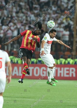 ES Tunis player Ibrahim Ouattara (L) in action against Zamalek player Tarek Hamed (R) during the CAF Champions League quarterfinal, first leg, soccer match between Zamalek and ES Tunis at Cairo Stadium in Cairo, Egypt, 28 February  2020.