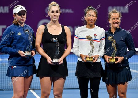 Su-Wei Hsieh (2-R) of Taiwan and Barbora Strycova (R) of Czech Republic  pose with their trophy after winning the doubles final match against runner-up winners Gabriela Dabrowski (2-L) of Canada and Jelena Ostapenko (L) of Latvia at the WTA Qatar Ladies Open tennis tournament in Doha, Qatar, 28 February 2020.