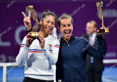 Su-Wei Hsieh (L) of Taiwan and Barbora Strycova  (R) of Czech Republic pose with their trophy after winning the doubles final match against  Gabriela Dabrowski of Canada and Jelena Ostapenko of Latvia at the WTA Qatar Ladies Open tennis tournament in Doha, Qatar, 28 February 2020.
