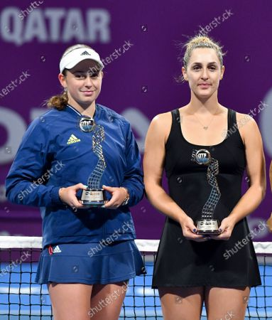 Gabriela Dabrowski (R) of Canada and Jelena Ostapenko (L) of Latvia hold their runner-up trophies after losing to Su-Wei Hsieh of Taiwan and Barbora Strycova of Czech Republic doubles final at the WTA Qatar Ladies Open tennis tournament in Doha, Qatar, 28 February 2020.