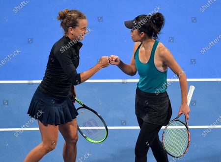 Su-Wei Hsieh  (R) of Taiwan and Barbora Strycova (L) of Czech Republic  in action during her XDoubles Final match againstGabriela Dabrowski of Canada and Jelena Ostapenko of Latvia at the WTA Qatar Ladies Open tennis tournament in Doha, Qatar, 28 February 2020.