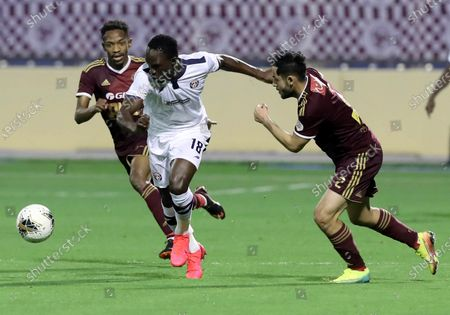 Al-Faisaly's Abdullah Al Hassan (R) in action against Al-Adalah's Adama Traore (C) And Al- Al-Faisaly's Khaled Kaabi (L) during the Saudi Professional League soccer match between Al-Faisaly and  Al-Adalah at Prince Abdullah bin Jalawi Sports City Stadium, Al-Hasa, Saudi Arabia, 28 February 2020.