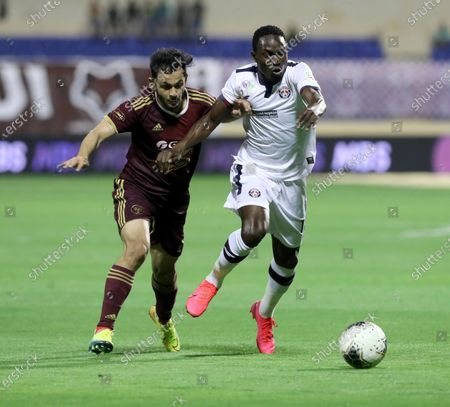 Al-Faisaly's Abdullah Al Hassan (L) in action against Al-Adalah's Adama Traore (R) during the Saudi Professional League soccer match between Al-Adalah and Al-Faisaly at Prince Abdullah bin Jalawi Sports City Stadium, Al-Hasa, Saudi Arabia, 28 February 2020.
