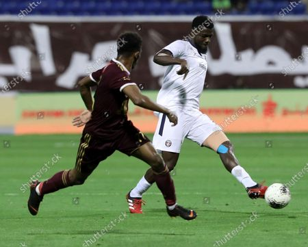 Al-Faisaly's Khaled Kaabi (L) in action against Al-Adalah's John Ogu (R) during the Saudi Professional League soccer match between Al-Adalah and Al-Faisaly at Prince Abdullah bin Jalawi Sports City Stadium, Al-Hasa, Saudi Arabia, 28 February 2020.
