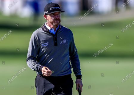 Jimmy Walker of the US prepares to spot his ball in the ninth hole during the second round of The Honda Classic golf tournament on the Champions Course at the PGA National Resort & Spa in Palm Beach Gardens, Florida, USA, 28 February 2020.