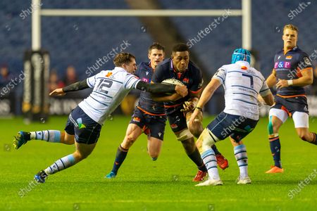 Viliame Mata (#8) of Edinburgh Rugby attempts to break the tackles of Ben Thomas (#12) and Olly Robinson (#7) of Cardiff Blues during the Guinness Pro 14 2019_20 match between Edinburgh Rugby and Cardiff Blues at BT Murrayfield Stadium, Edinburgh