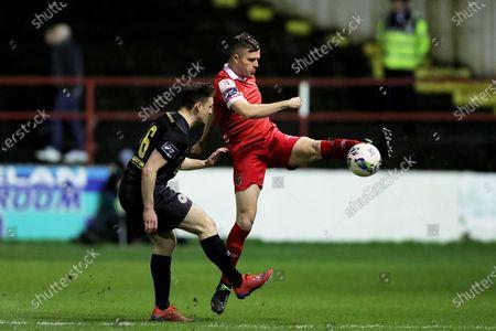 Shelbourne vs St. Patrick's Athletic. Shelbourne's Alex O'Hanlon under pressure from Jason McClelland of St. Patrick's Athletic